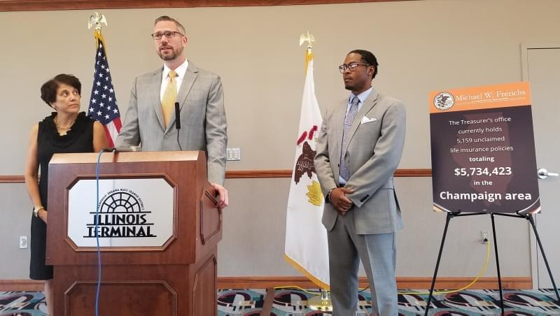 Savoy resident Doris McGee, State Treasurer Mike Frerichs and Andre Jordan, of AARP Illinois.
