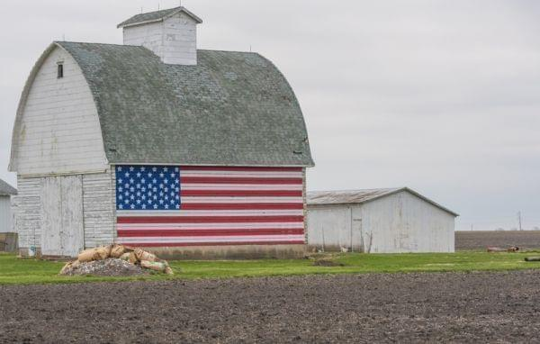 A barn with an American flag painted on the side sits on High Cross Road east of Urbana, Ill., in Champaign County.