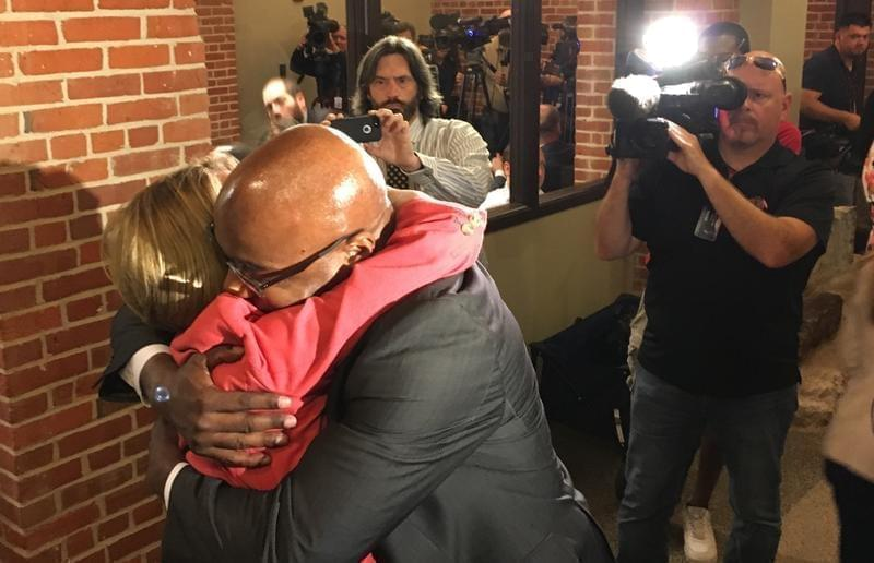 Several Democratic Senators, including Kwame Raoul of Chicago, were waiting to hug Republican Leader Christine Radogno after the news conference where she discuussed her resignation.