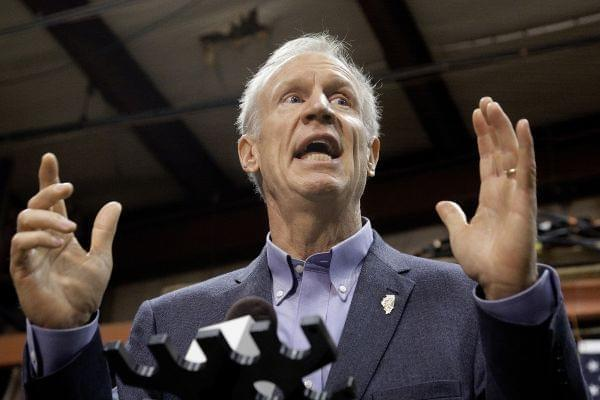 Gov. Bruce Rauner speaks to reporters in Springfield, Ill. The Illinois House passed both a budget and an income-tax increase Sunday, but Gov. Bruce Rauner has promised to veto the tax-hike.