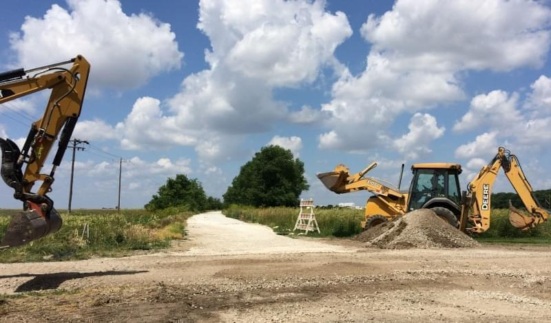 Construction workers work west of St. Joseph on the first segment of Kickapoo Rail Trail.