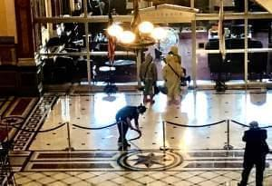 Hazmat crew enters the governor's office at the Illinois Statehouse Thursday. .