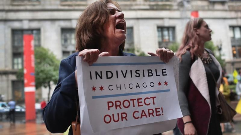 Demonstrators protest changes to the Affordable Care Act on June 28, 2017, in Chicago, Illinois.