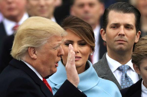 Donald Trump Jr., far right during his father's inauguration, has released an email exchange about setting up a meeting in 2016 with a Russian lawyer who he is told has damaging information about Hillary Clinton.