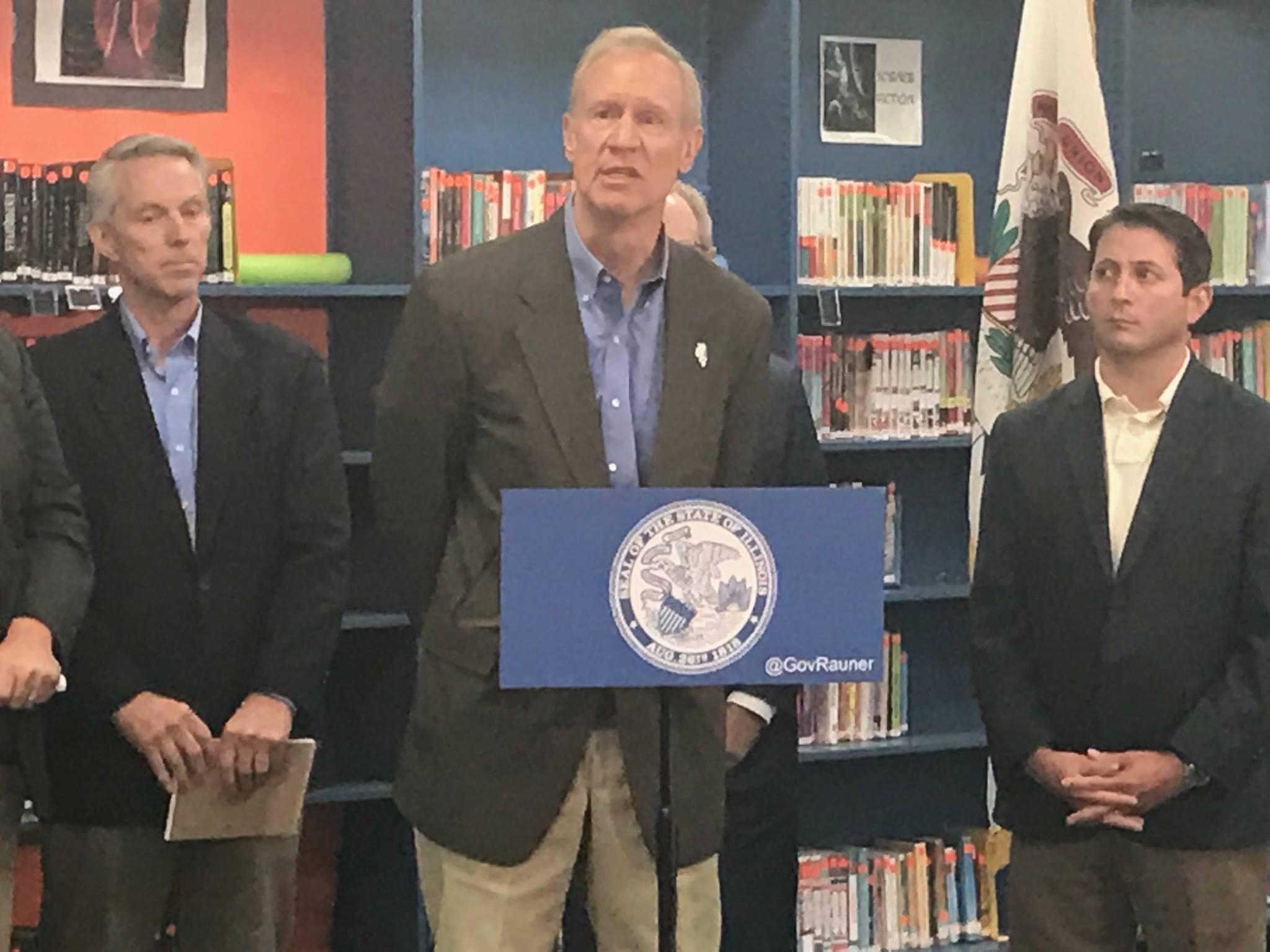 """Gov. Bruce Rauner holds a press conference in Mt. Zion Junior High School to """"demand"""" that Democrats send him their school funding plan so that he can veto parts of it."""