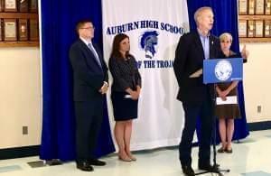 Gov. Bruce Rauner, flanked by Auburn Supt Darren Root, and St. Representatives Avery Bourne, Sara Wojcicki Jimenez.