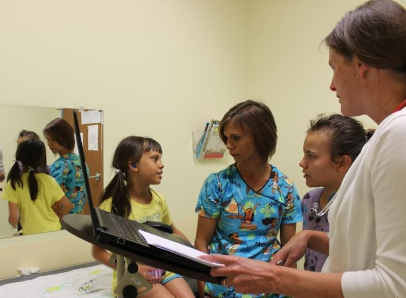 Dr. Kristin Stahl (far right) of Heartland Pediatrics meets with patient, Makayla (far left), who came in for a physical exam on July 26 along with her mother, Wendy Kelly, and older sister, Laney.