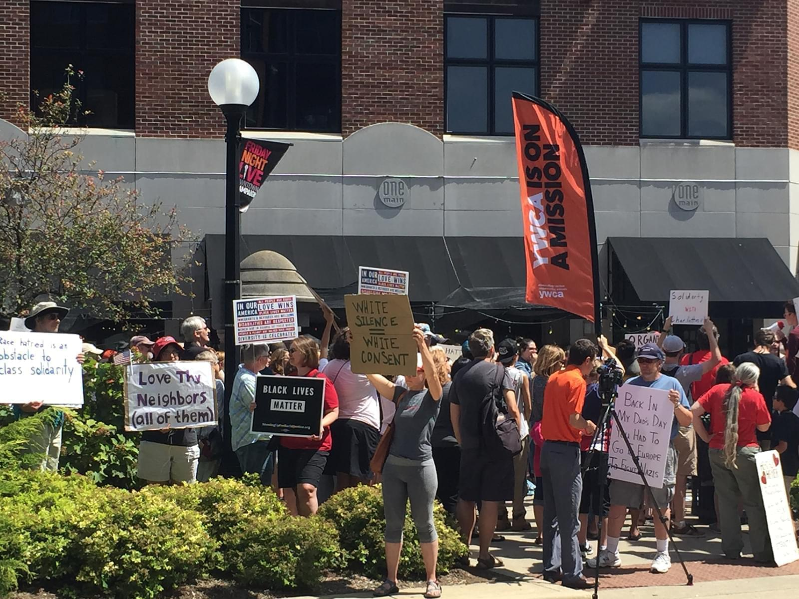 A crowd rallies against fascism and racism Sunday in downtown Champaign.