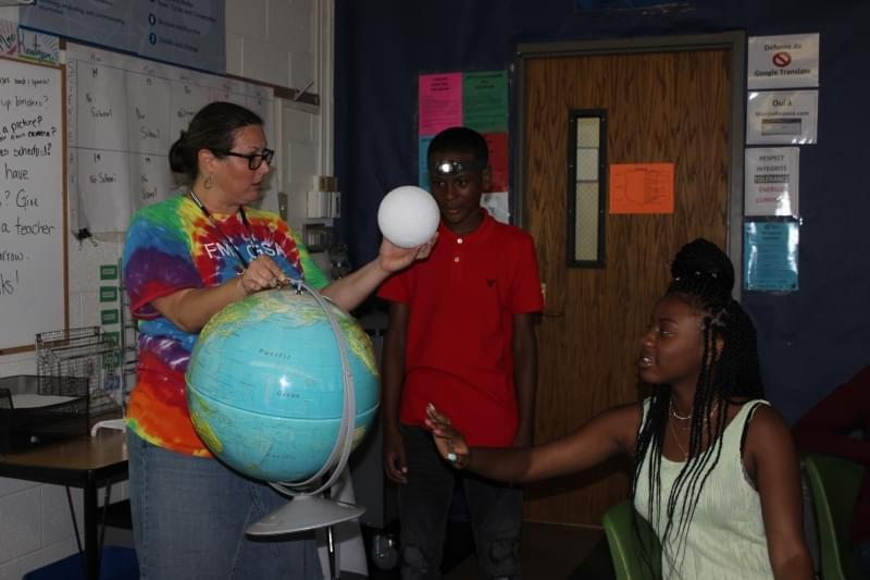 Kate Higgs, 8th grade science teacher at Franklin Middle School in Champaign, explains what will happen during Monday's solar eclipse.