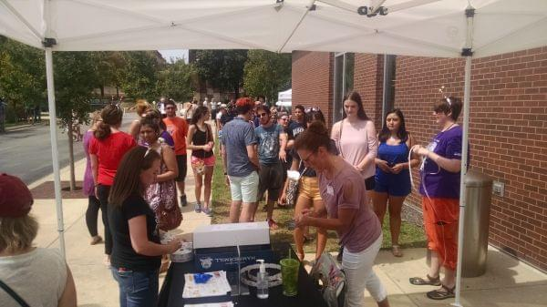 People line up at the Champaign Public Library to receive special glasses to view the solar eclipse.