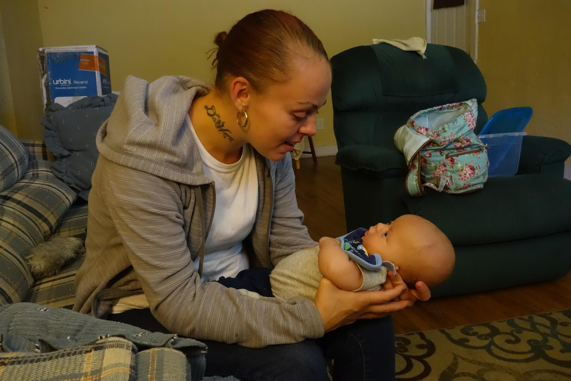 Tia Hosler holds her 2-month-old son, Marsean.