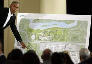President Barack Obama points to a plan for the Obama Presidential Center in Chicago.