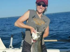 Recreational angler Carol Sabaj of Champaign with a 14lb Chinook (King) Salmon caught in July on Lake Michigan out of Waukegan Harbor, Waukegan IL.