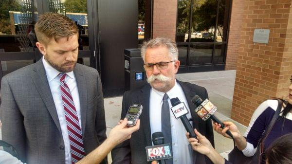 Christensen lawyers Evan and Tom Bruno meet the media outside Urbana Federal Court