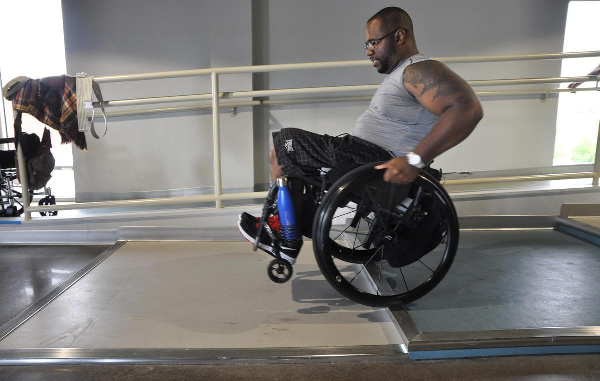Aaron Murray pops a wheelie at the ParaQuad gym in St. Louis