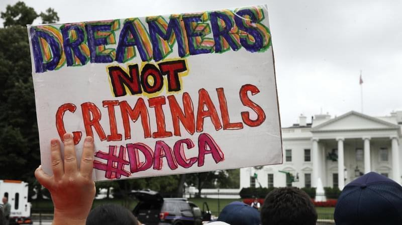 A woman holds up a signs in support of the Obama administration program known as Deferred Action for Childhood Arrivals, or DACA, during a rally on Aug. 15 at the White House.
