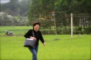 Le Ly Hayslip walking in a Vietnamese field