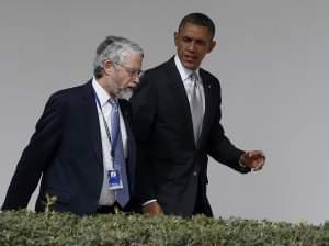 In this file photo, then-President Barack Obama walks with John P. Holdren, Assistant to the President for Science and Technology and Director of the White House Office of Science and Technology Policy, at the White House in Washington, Friday, March