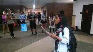 Shameen Razack, president of the Parkland College Social Justice Club, leads a protest of police treatment of minorities.