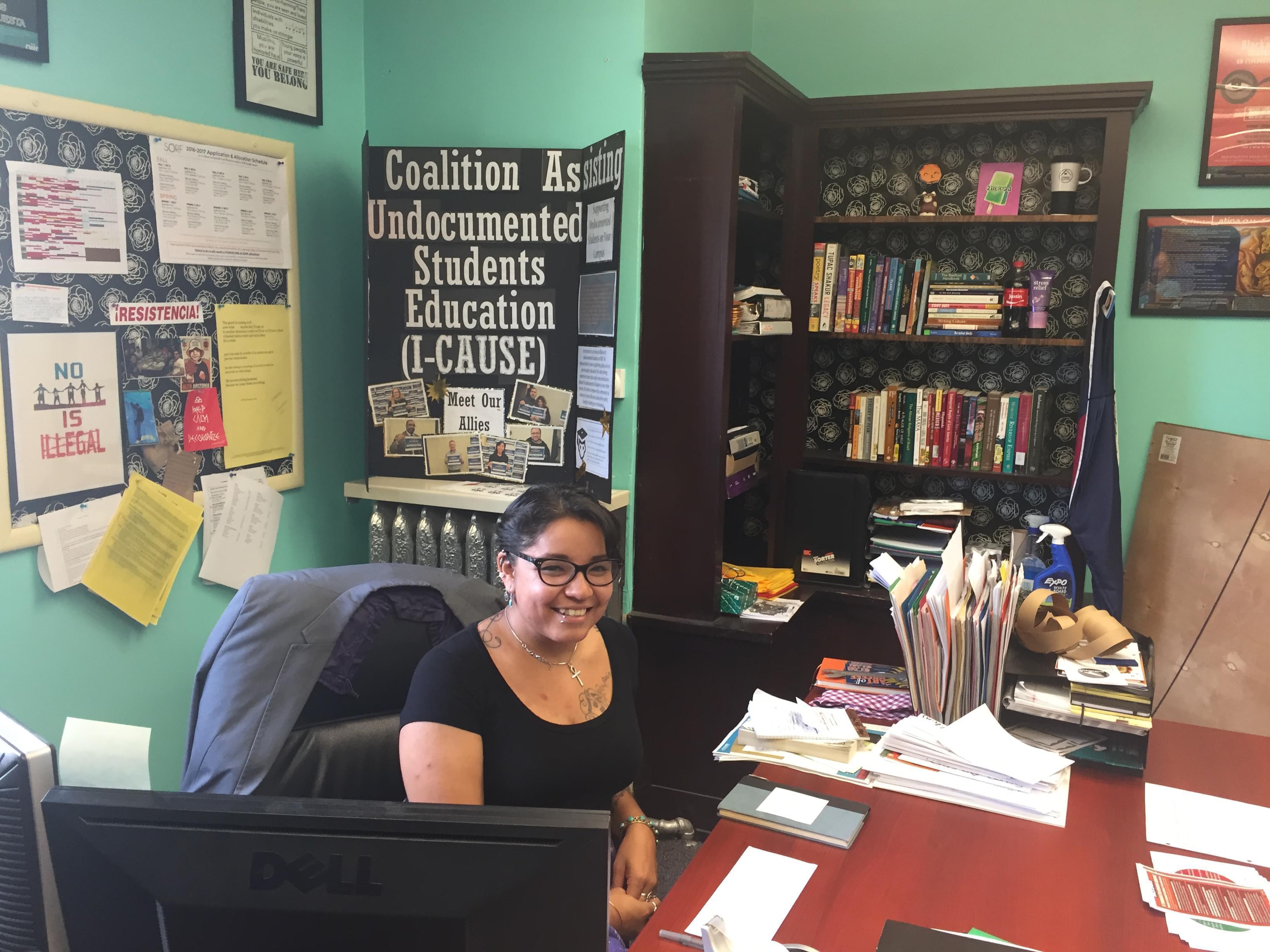 Nancy Ramirez-Blancas sits at her desk inside La Casa Cultural Latina on the University of Illinois Urbana campus.