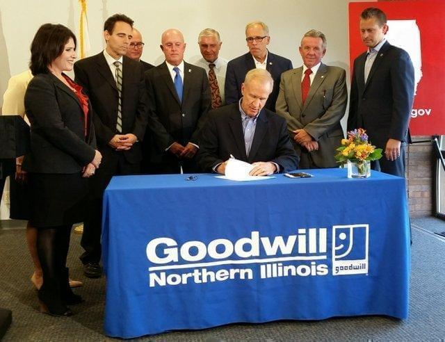 Gov. Bruce Rauner signs high school diploma legislation at Goodwill in Rockford.