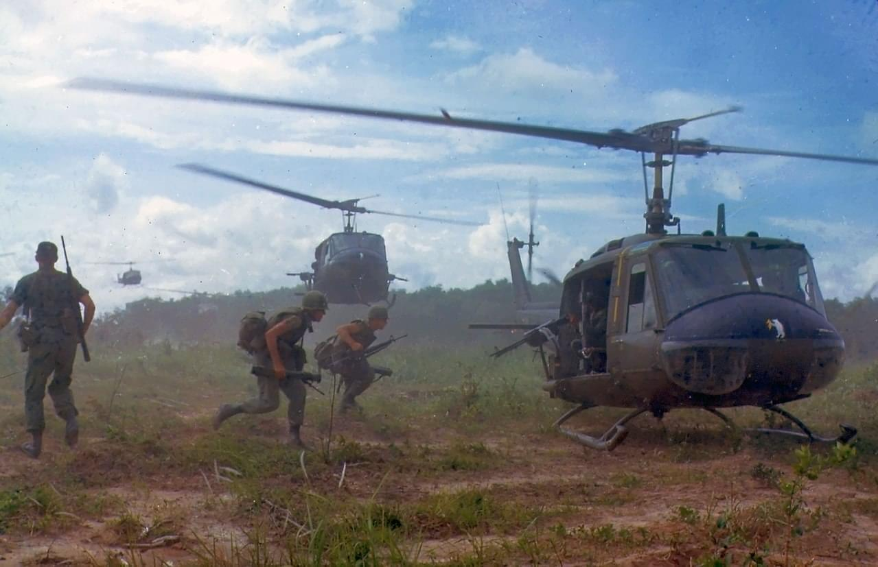 helicopters airlift members of a U.S. infantry regiment in Vietnam