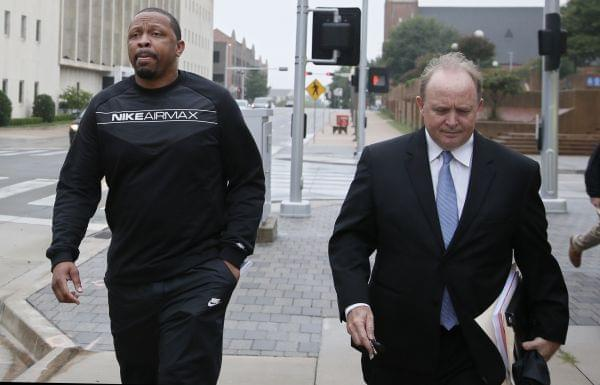 Lamont Evans, left, an assistant basketball coach at Oklahoma State University, and his attorney Trace Morgan leave the federal courthouse following a court appearance in Oklahoma City, Wednesday, Sept. 27, 2017.