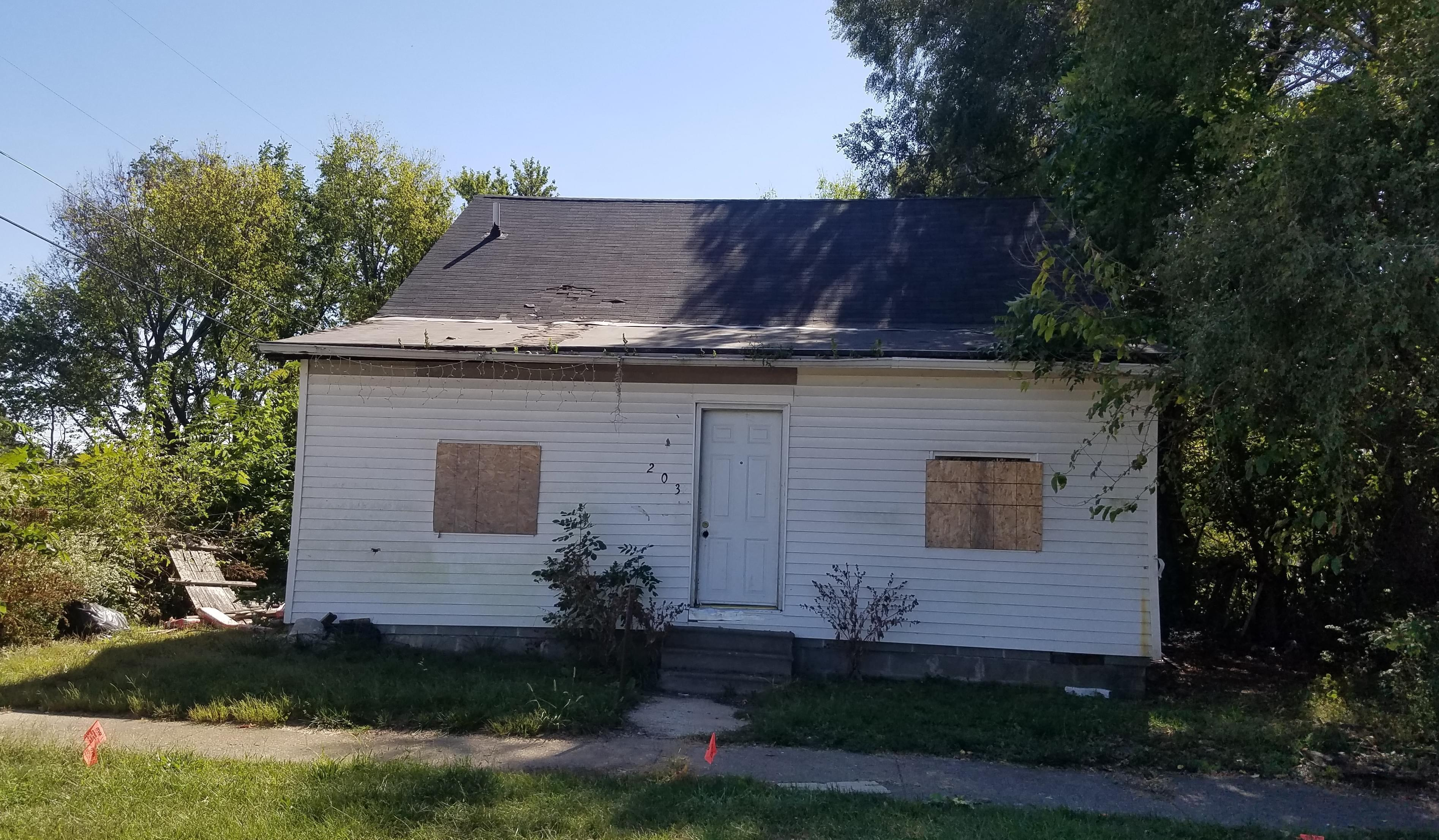 A boarded-up house in Champaign's Bristol Place neighborhood.