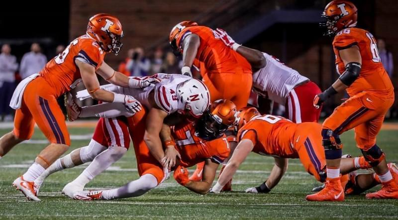 Nebraska Linebacker Chris Weber (49)  tackles Illinois quarterback Chayce Crouch (7) in Nebraska's 28-6 win Friday night.