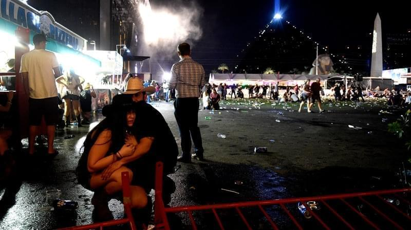 People take cover at the Route 91 Harvest country music festival after a gunman opened fire on the festival from a room in the Mandalay Bay Resort and Casino in Las Vegas, Nevada.