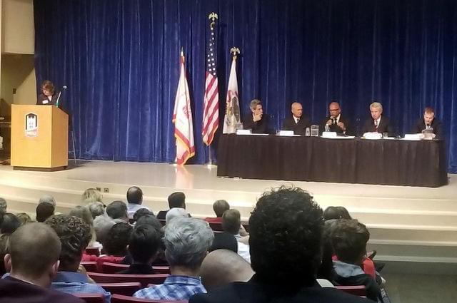 Democratic gubernatorial forum at Northern Illinois University. Left to right: WNIJ's Susan Stephens as moderator. Candidates Daniel Biss, Bob Daiber, Tio Hardiman, Chris Kennedy, and Alex Paterakis