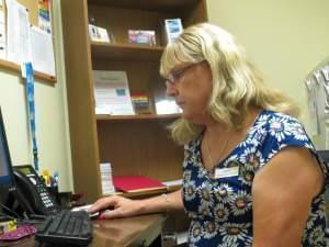 Dana Garber helps patients with transition-related medical care at the Peoria, Ill. Planned Parenthood.