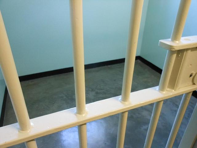 Photo of a jail cell.