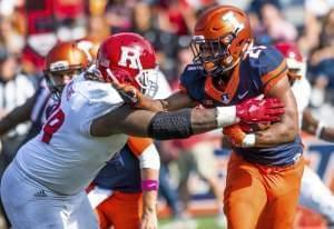 Illinois running back Ra'Von Bonner is tackled by Rutgers defensive lineman Kevin Wilkins.