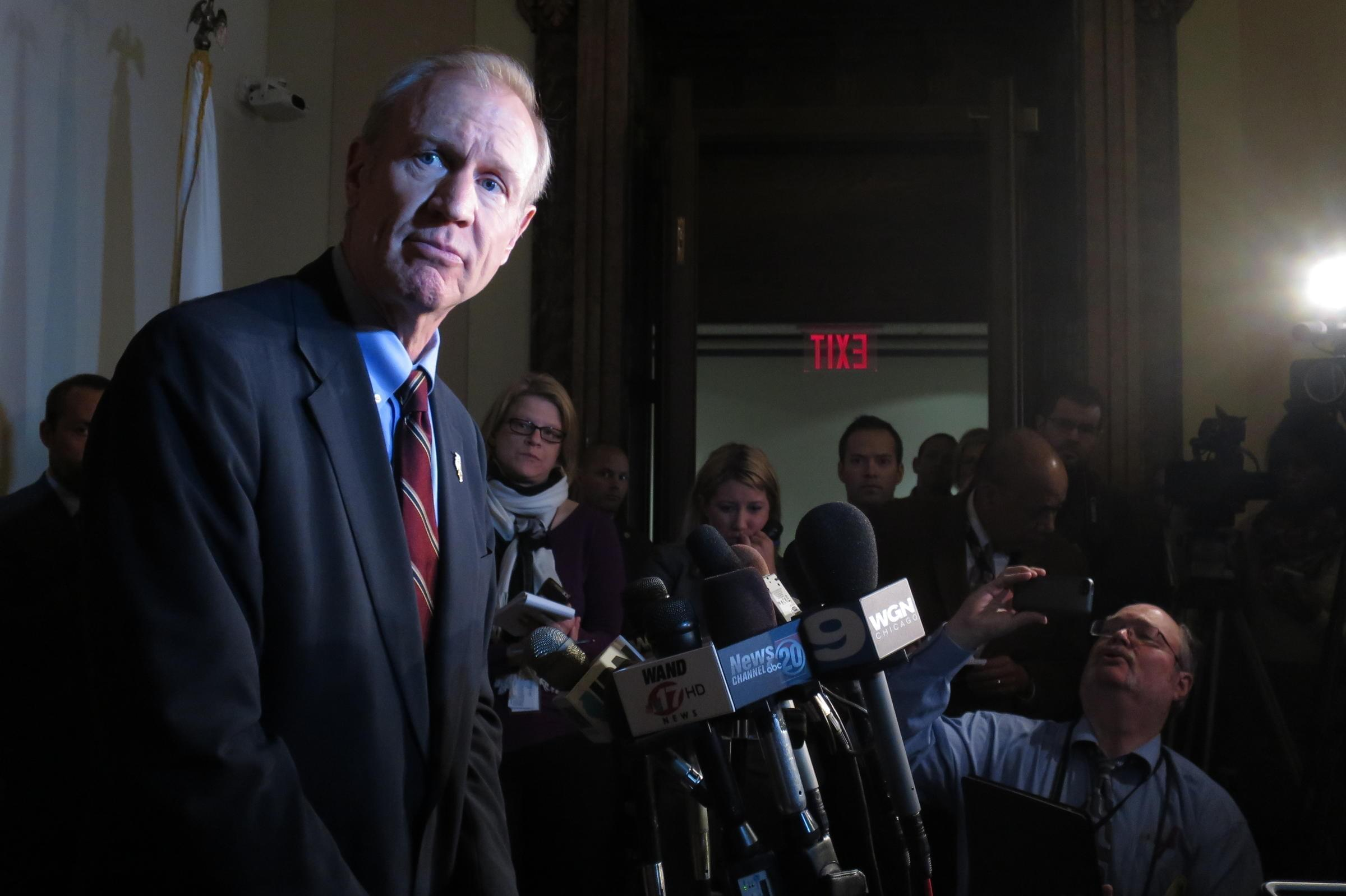 In this file photo, Gov. Bruce Rauner talks with reporters in Springfield.