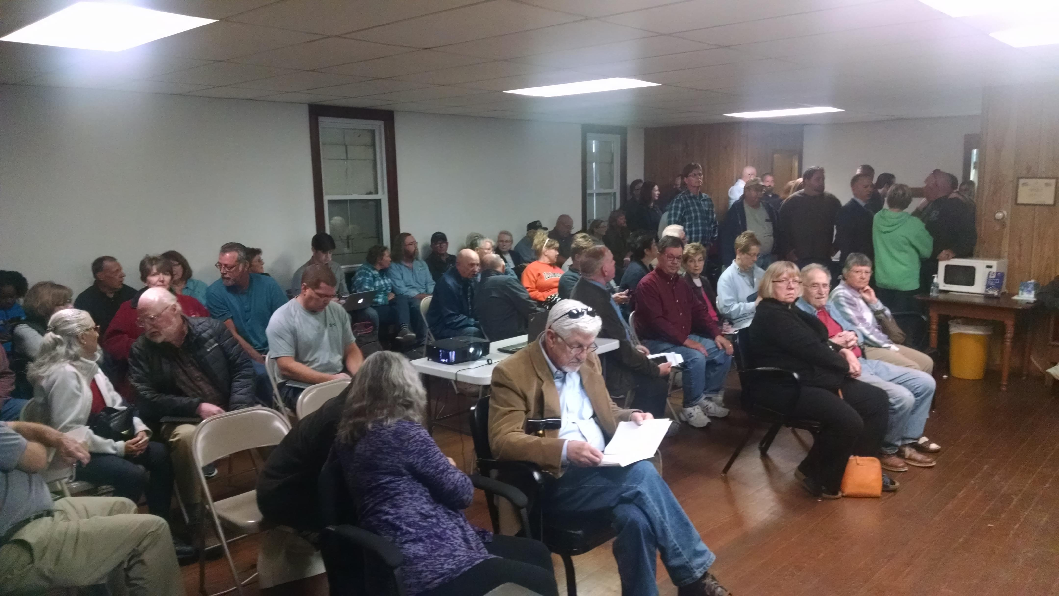 Over 100 people attended an informational meeting Monday night in Newcomb Township about a natural gas leak that contaminated five private water wells.