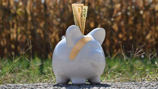 Piggy bank with a band-aid.