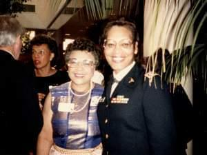 two women, Constance Edwards in uniform on the right