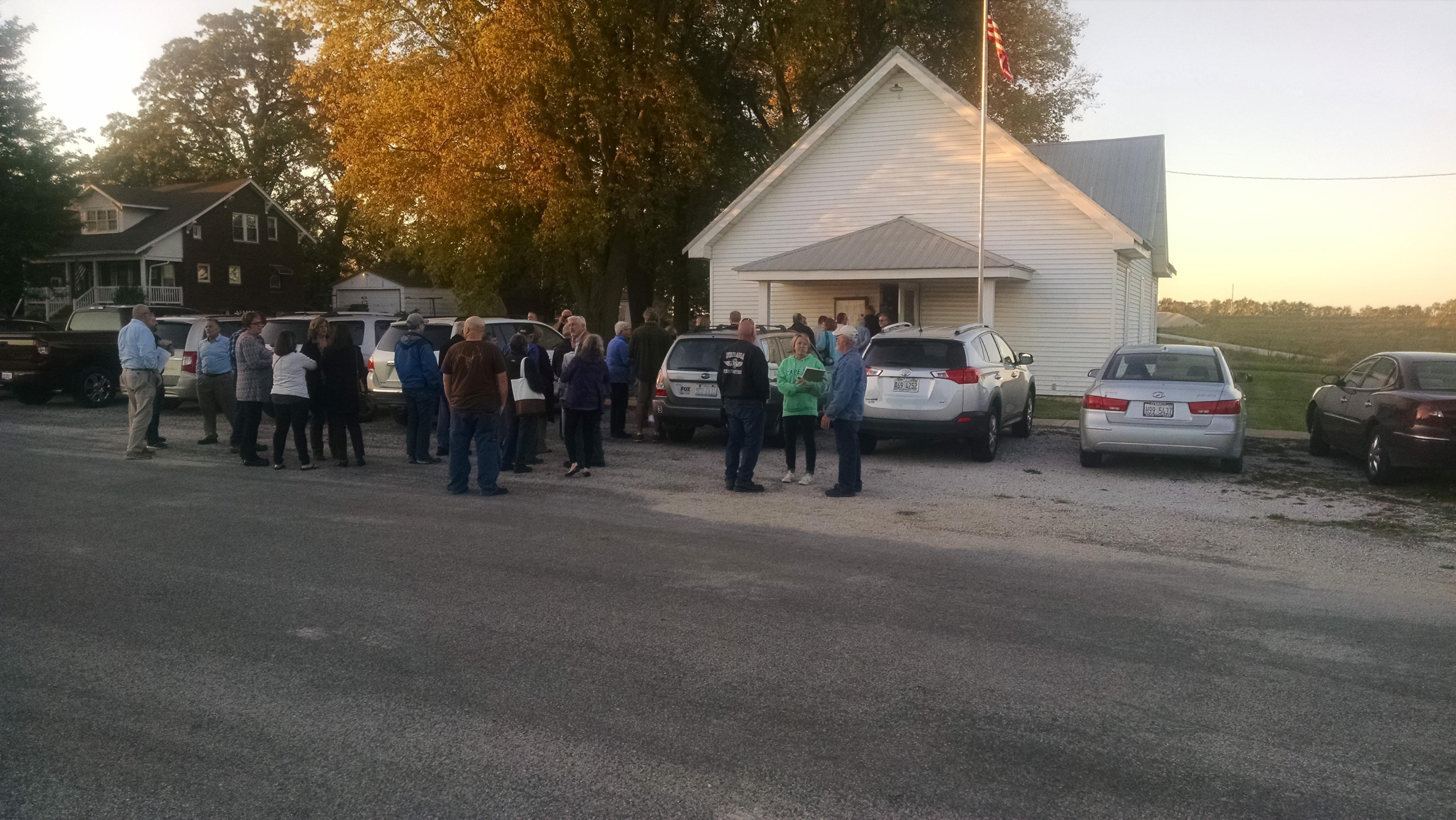 Residents father outside the Newcomb Township Hall on October 16, to hear the latest information from Spiros Law about the natural gas leak between Mahomet and Fisher.
