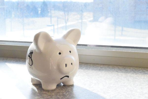 Piggy bank with sad face.