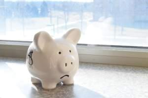 Piggy bank with sad face.