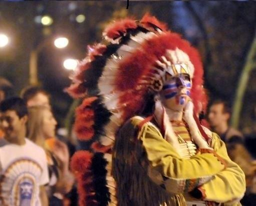 A student portraying the retired Chief Illiniwek.