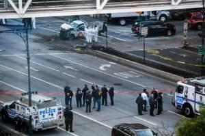 Investigators in New York City inspect a truck after a suspect plowed a vehicle into a bike and pedestrian path in Lower Manhattan and struck another vehicle on Tuesday, killing eight people and injuring at least 11 others.