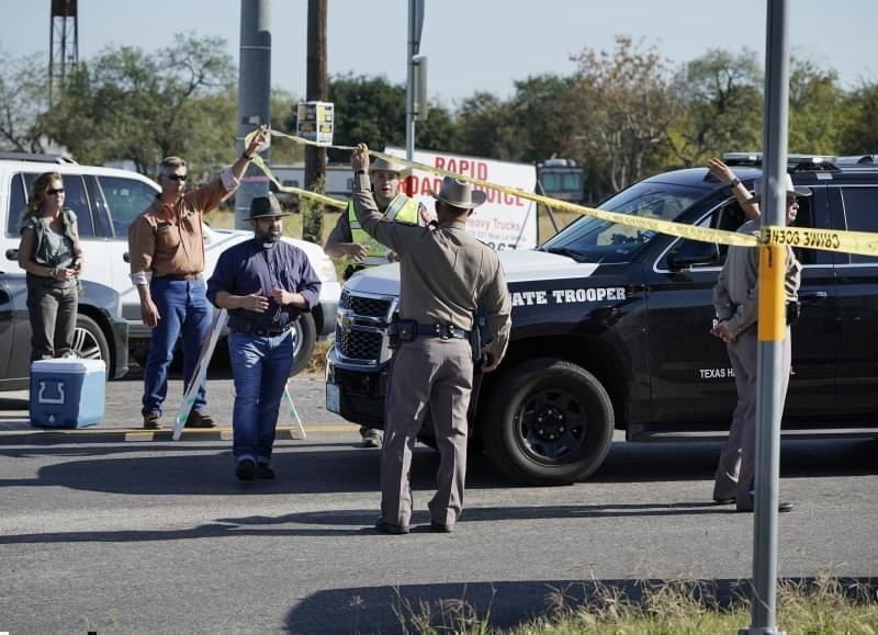 Law enforcement officers man a barricade near the First Baptist Church of Sutherland Springs after a fatal shooting, Sunday, Nov. 5, 2017, in Sutherland Springs, Texas.
