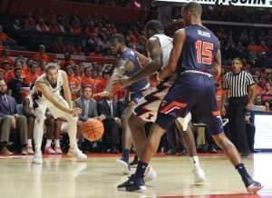 Michael Finke passes to teammate Leron Black in a 77-74 win over Tennessee-Martin.