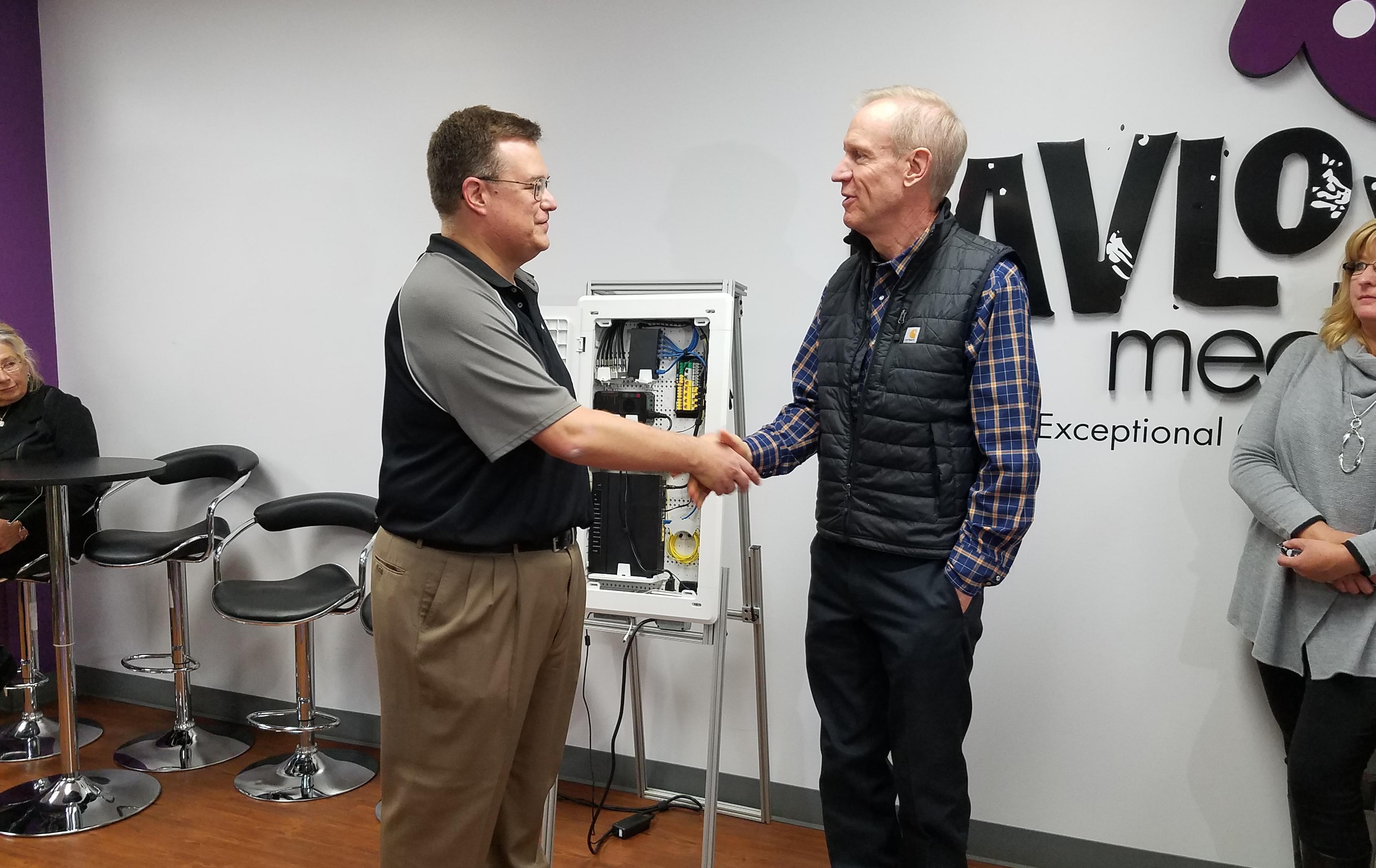 Pavlov Media CEO Mark Scifres and Gov. Bruce Rauner.