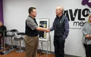 Pavlov Media CEO Mark Scifres and Gov. Bruce Rauner.