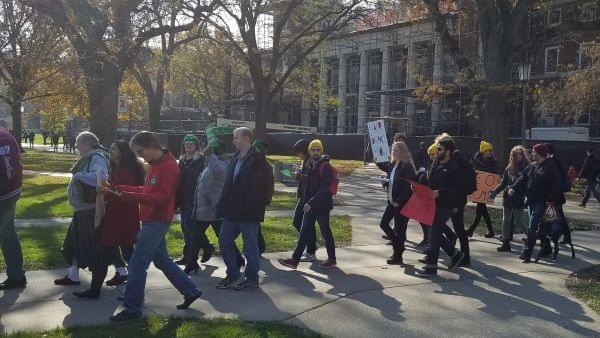 Members and supporters of AFSCME Locals 3700 & 678 demonstrate on the University of Illinois Urbana campus Main Quad Tuesday/