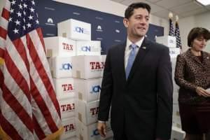 Speaker of the House Paul Ryan, R-Wis., followed at right by Rep. Cathy McMorris Rodgers, R-Wash., walks past boxes of petitions supporting the Republican tax reform bill that is set for a vote later this week as he arrives for a news conference on C