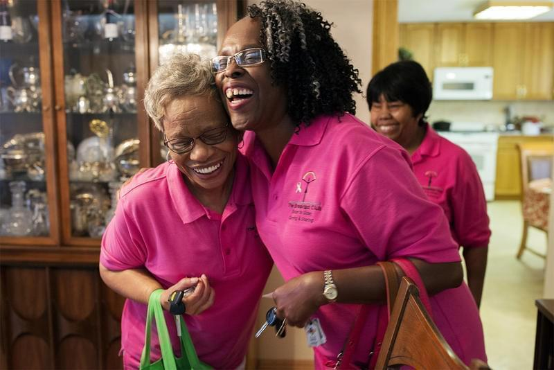 Ella Jones, left, and Diane Stevenson hug goodbye after a meeting of the Breakfast Club, a group that offers support and friendship to women diagnosed with breast cancer.